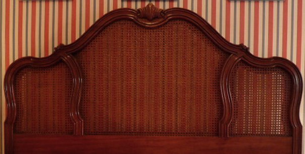 French Provencal  style headboard with caned inset panels.