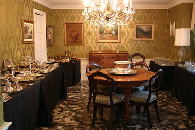 Dining room packed with silverplate, some sterling and tons of crystal.