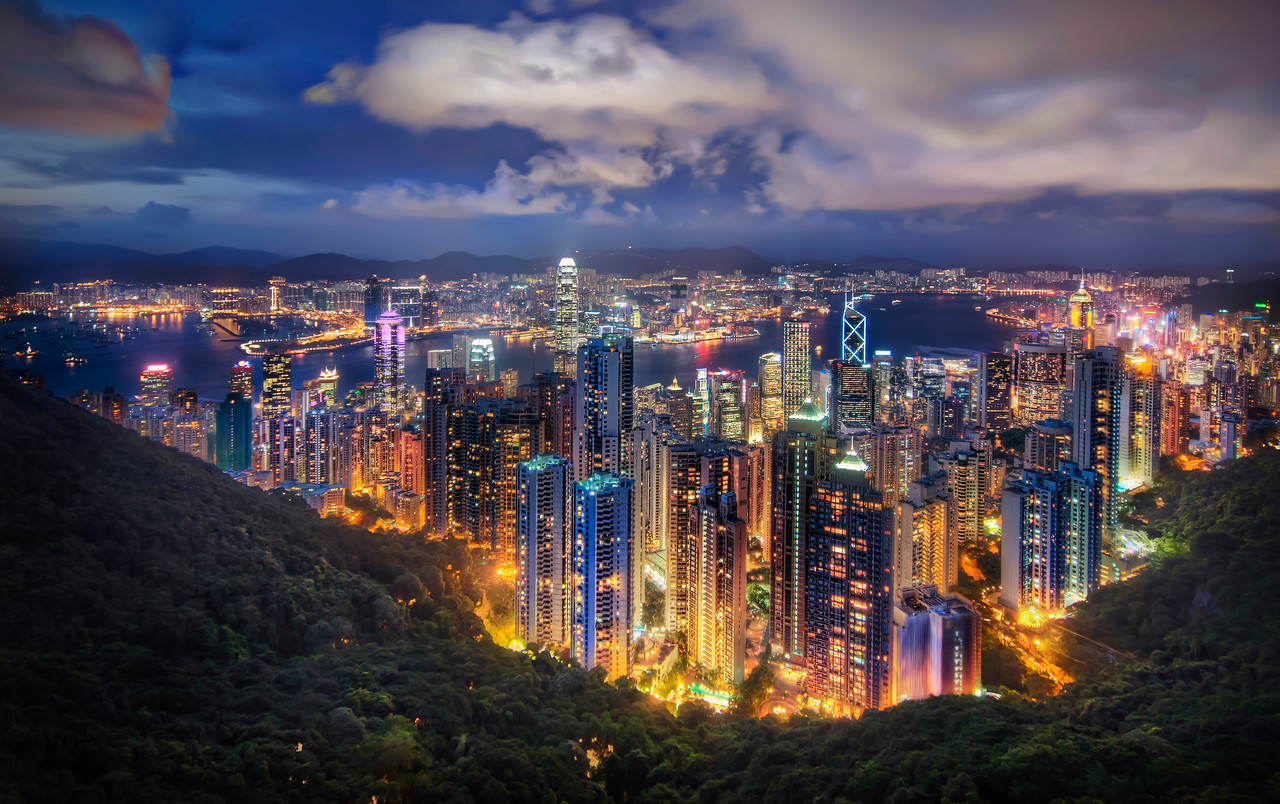 """<h2>Hong Kong from the Peak on a Summer's Night</h2> <br/>If you want to see how I made this (and how you can too!), visit my HDR Tutorial. I hope it gives you some new tricks!<br/><br/>I had a long day waking up at 5 AM to take a series of subways and trains up to Shenzen for some meetings. I had a Chinese VISA, which you don't need to get into Hong Kong, but I had to use to cross the official Chinese border after getting off the train. I didn't realize that it was a one-time use VISA, and I had to go to Shanghai the next day. This caused a lot of problems with the Chinese officials, a body of government with which I do not enjoy causing problems.<br/><br/>Anyway, after I got back to Hong Kong after a day in Shenzen, I was hot and sweaty and in the sort of meeting clothes that aren't great for being hot and sweaty in. But, everything about Hong Kong was still awesome and I had too look hard for things to complain about. The sun was setting, and I made it up to The Peak just in time for a shot.<br/><br/>This was a 5-exposure HDR shot at 100 ISO, and, of course, a sturdy tripod to get all the lights as steady as possible.<br/><br/>- Trey Ratcliff<br/><br/><a href=""""http://www.stuckincustoms.com/2007/07/30/hong-kong-from-the-peak-on-a-summer-night/"""" rel=""""nofollow"""">Click here to read the rest of this post at the Stuck in Customs blog.</a>"""