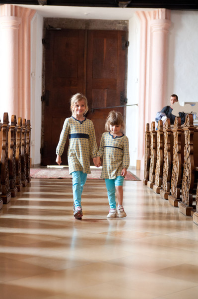 Elisabeth and Charlotte walking down the same aisle as Maria in the Sound of Music.