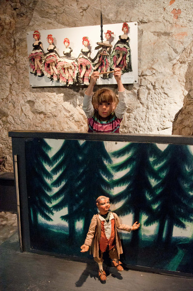 Charlotte operates a marionette in the marionette museum of Salzburg Castle.