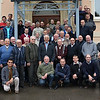 Participants of the European Conference on Secularity quickly pose for a photo between rain showers.