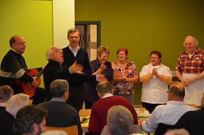 Fr. Tullio Benini leads everyone in song to thank the kitchen staff