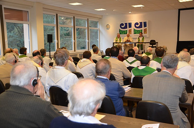 Participants started the closing mass in the meeting hall so that they could use the translation assistance for the homily.