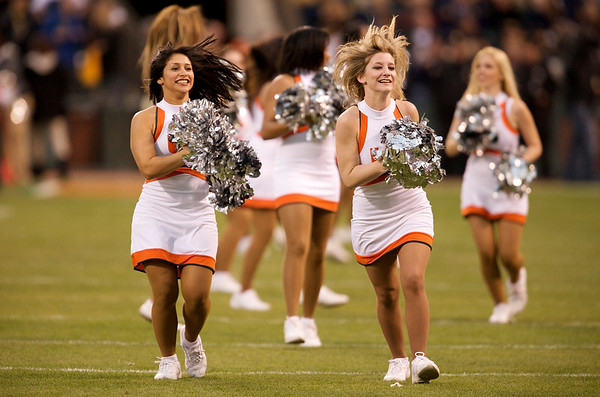 27 December 2008:  Miami Hurricanes cheerleaders run on to the field before the first half of the 2008 Emerald Bowl between the California Golden Bears and the Hurricanes at AT&T Park in San Francisco, California.  The Golden Bears prevailed 24-17 over the Hurricanes.