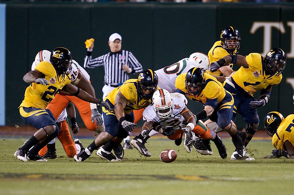 27 December 2008:  Miami Hurricanes running back Graig Cooper (2) fumbles during the second half of the California Golden Bears' 24-17 victory over the Hurricanes in 2008 Emerald Bowl at AT&T Park in San Francisco, California.