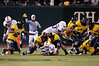27 December 2008:  Miami Hurricanes running back Graig Cooper (2) recovers his own fumble during the second half of the California Golden Bears' 24-17 victory over the Hurricanes in 2008 Emerald Bowl at AT&T Park in San Francisco, California.