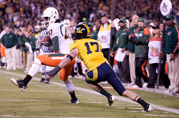 27 December 2008:  Miami Hurricanes wide receiver Laron Byrd (47) makes a catch in front of California Golden Bears cornerback Chris Conte (17) during the second half of the Golden Bears' 24-17 victory over the Hurricanes in 2008 Emerald Bowl at AT&T Park in San Francisco, California.