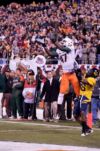 27 December 2008:  Miami Hurricanes wide receiver Laron Byrd (47) catches a touchdown pass in the end zone over California Golden Bears defensive back Darian Hagan (26) during the first half of the 2008 Emerald Bowl between the Golden Bears and the Hurricanes at AT&T Park in San Francisco, California.  The Golden Bears prevailed 24-17 over the Hurricanes.