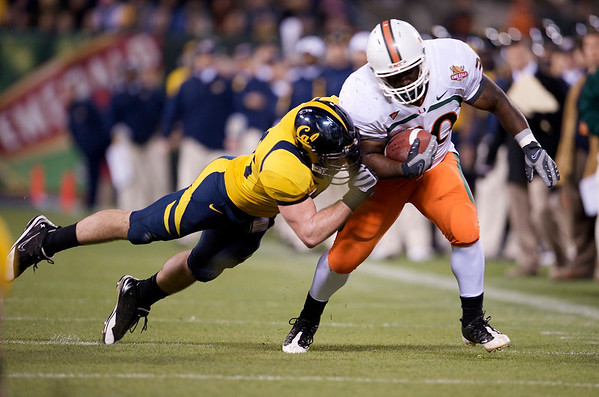 27 December 2008:  Miami Hurricanes fullback Patrick Hill (30) takes a hit during the second half of the California Golden Bears' 24-17 victory over the Hurricanes in 2008 Emerald Bowl at AT&T Park in San Francisco, California.