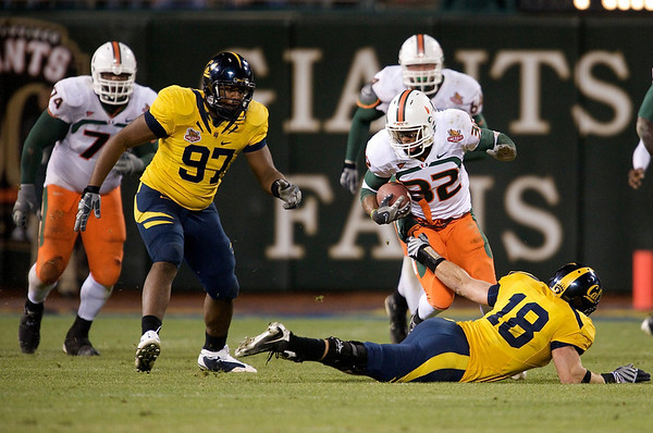 27 December 2008:  California Golden Bears linebacker Michael Mohamed (18) reaches up to stop Miami Hurricanes running back Lee Chambers (32) during the second half of the Golden Bears' 24-17 victory over the Hurricanes in 2008 Emerald Bowl at AT&T Park in San Francisco, California.