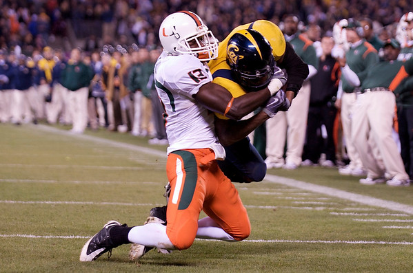 27 December 2008:  Miami Hurricanes defensive tackle Ryan Hill (13) stops California Golden Bears running back Jahvid Best (4) on the one yard-line during the second half of the Golden Bears' 24-17 victory over the Miami Hurricanes in 2008 Emerald Bowl at AT&T Park in San Francisco, California.