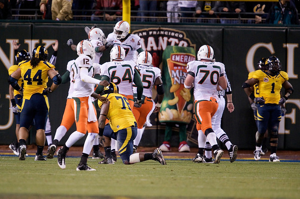 27 December 2008:  Miami Hurricanes wide receiver Thearon Collier (28) celebrates a touchdown during the second half of the California Golden Bears' 24-17 victory over the Hurricanes in 2008 Emerald Bowl at AT&T Park in San Francisco, California.