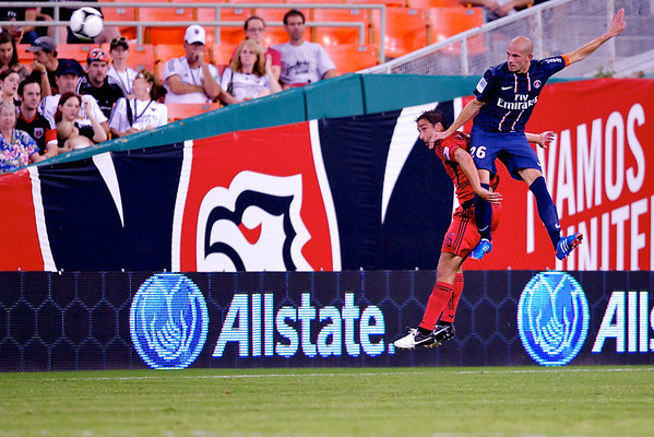 28 July 2012:  Paris Saint-Germain Defender Christophe Jallet (26) leaps over DC United Forward Josh Wolff (16) during DC United's international friendly match against Paris Saint-Germain at RFK Stadium in Washington, DC.