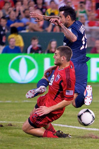 28 July 2012:  DC United Defender Chris Korb (22) stops Paris Saint-Germain Forward Ezequiel Lavezzi (11) in front of the goal during DC United's international friendly match against Paris Saint-Germain at RFK Stadium in Washington, DC.
