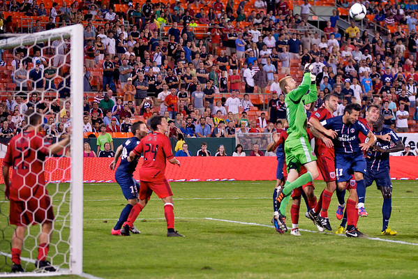 28 July 2012:  DC United Goalkeeper Joe Willis (31) punches the ball away from the goal over Paris Saint-Germain Forward Ezequiel Lavezzi (11) during DC United's international friendly match against Paris Saint-Germain at RFK Stadium in Washington, DC.