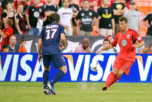 28 July 2012:  DC United Defender Emiliano Dudar (19) passes past Paris Saint-Germain Defender Maxwell (17) during DC United's  international friendly match against Paris Saint-Germain at RFK Stadium in Washington, DC.
