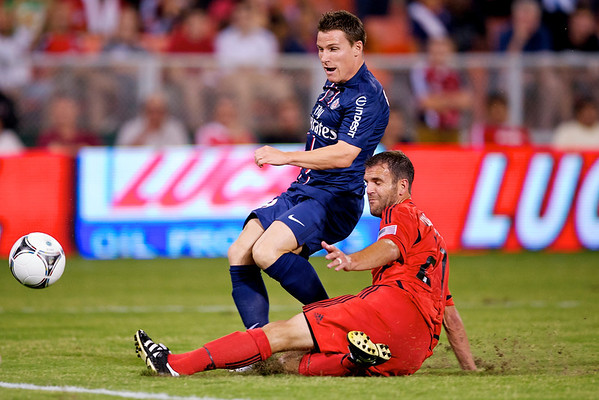 28 July 2012:  DC United Midfielder Kurt Morsink (6) tackles Paris Saint-Germain Forward Kévin Gameiro (19) during DC United's international friendly match against Paris Saint-Germain at RFK Stadium in Washington, DC.