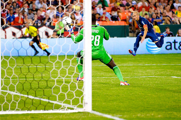 28 July 2012:  Paris Saint-Germain Defender Christophe Jallet (26) shoots on DC United Goalkeeper Bill Hamid (28) during DC United's international friendly match against Paris Saint-Germain at RFK Stadium in Washington, DC.