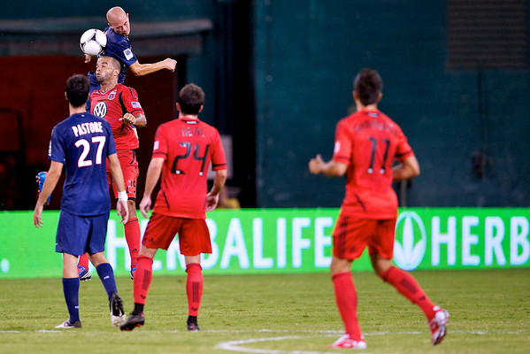28 July 2012:  Paris Saint-Germain Defender Christophe Jallet (26) leaps over DC United Midfielder Lance Rozeboom (25) for a header during DC United's international friendly match against Paris Saint-Germain at RFK Stadium in Washington, DC.