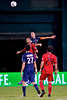 28 July 2012:  Paris Saint-Germain Defender Christophe Jallet (26) leaps over DC United Midfielder Lance Rozeboom (25) for a header during DC United's international friendly match against Paris Saint-Germain at RFK Stadium in Washington, DC.