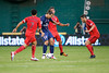 28 July 2012:  Paris Saint-Germain Forward Zlatan Ibrahimovi? (18) dribbles through DC United Midfielder Dwayne De Rosario (7) and DC United Midfielder Branko Boskovic (8) during DC United's  international friendly match against Paris Saint-Germain at RFK Stadium in Washington, DC.