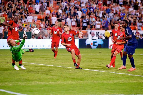28 July 2012:  DC United Goalkeeper Joe Willis (31) dives to stop a shot by Paris Saint-Germain Forward Péguy Luyindula (8) during DC United's international friendly match against Paris Saint-Germain at RFK Stadium in Washington, DC.