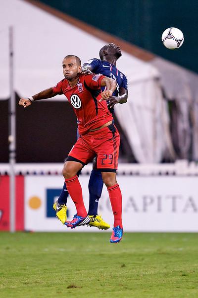 28 July 2012:  Paris Saint-Germain Defender Mamadou Sakho (3) battles with DC United Forward Maicon Santos (29) for a header during DC United's international friendly match against Paris Saint-Germain at RFK Stadium in Washington, DC.