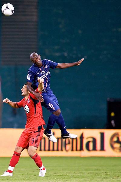 28 July 2012:  Paris Saint-Germain Defender Zoumana Camara (6) leaps over DC United Forward Hamdi Salihi (9) during DC United's international friendly match against Paris Saint-Germain at RFK Stadium in Washington, DC.