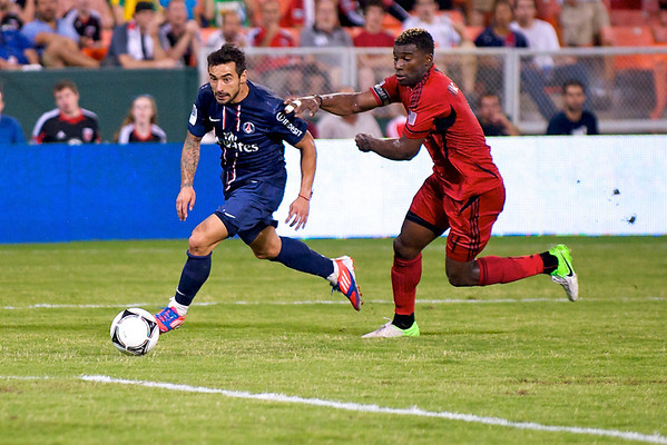 28 July 2012:  Paris Saint-Germain Forward Ezequiel Lavezzi (11) dribbles past DC United Defender Brandon McDonald (4) during DC United's international friendly match against Paris Saint-Germain at RFK Stadium in Washington, DC.