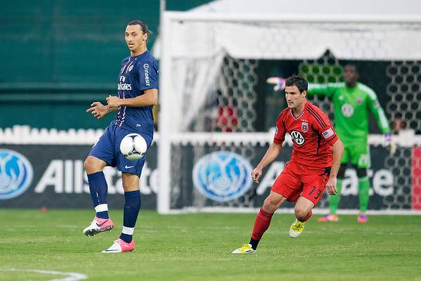 28 July 2012:  Paris Saint-Germain Forward Zlatan Ibrahimovi? (18) passes past DC United Midfielder/Forward Chris Pontius (13) during DC United's  international friendly match against Paris Saint-Germain at RFK Stadium in Washington, DC.