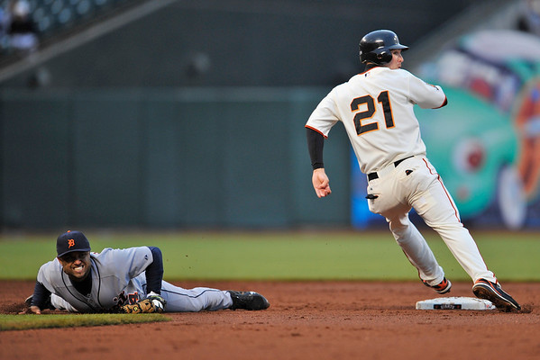 16 June 2008:  Placido Polanco (14) reacts to an errant throw as John Bowker (21) rounds second base during the San Francisco Giants' 8-6 victory over the Detroit Tigers at AT&T Park in San Francisco, CA.  The error allowed one run to score.