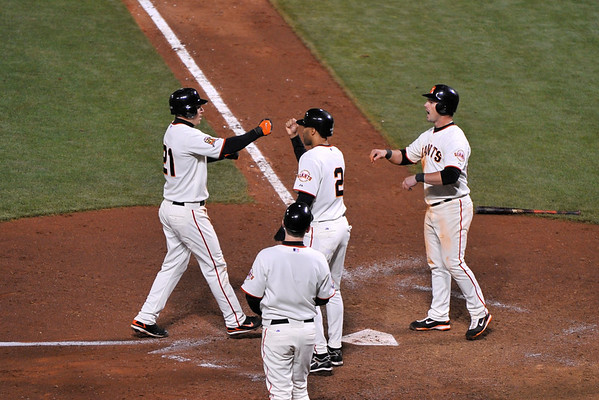 16 June 2008:  Aaron Rowand (33) and Randy Winn (2) greet John Bowker (21) after Bowker's 3-run homer put the Giants ahead in the bottom of the eighth inning during the San Francisco Giants' 8-6 victory over the Detroit Tigers at AT&T Park in San Francisco, CA.