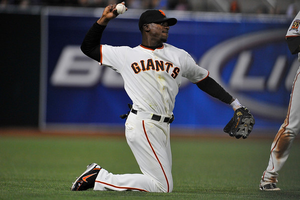 09 May 2008:  Fred Lewis (14) throws to the infield from his knees after failing to make a diving catch during the Philadelphia Phillies' 7-4 victory over the San Francisco Giants at AT&T Park in San Francisco, CA.