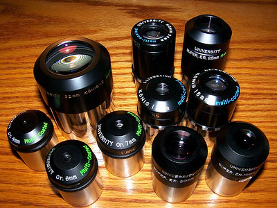 Part of the authors University Optics eyepiece collection.  Upper Left is a 32mm Konig II two inch eyepiece. Below left a number of Orthoscopics. Middle right are a mix of Konig I and Super Erfles.