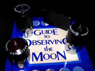 "Here are aseveral University Optics Konig eyepieces. Want can be seen here are the checkerboard or zebra style. They get the name from the aluminum ring that seperates the black portion of the eyepiece from the chrome barrel. This aluminum ""ring"" has an alternating pattern black to silver and back again kinda like a checkerboard or zebra might have!"