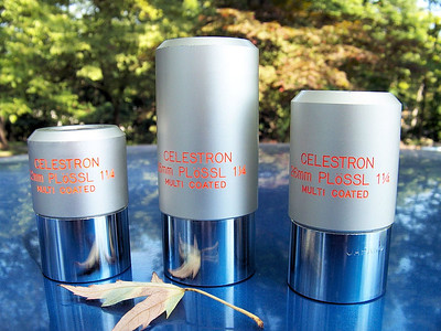 """Several examples of the Celestron Silver top Plossl eyepieces from the 1980's. Shown are the Japanese 22mm, 36mm and 26mm.  Note the double dots above the """"o"""" in the word PLoSSL on the above eyepieces."""