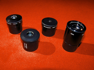 A few different Brandon eyepieces are in this image. The oldest has the horizontal inscription and dates from probably 1967. The 12mm on the far left is also quite old possibly from the late 1960's or early 1970's. Far right is a 50th anniversity Brandon from just a few years ago. The 8mm in the middle once was a gold plated Brandon but has been brought back to the staus of a regular Brandon eyepiece due to an over run in the number of gold eyepiece barrels produced or at least this is what I've been told. In any case I have been a Brandon eyepiece user since 1970 and feel documentation and examples of the various series maybe helpful to those who collect and wish to learn about these fine eyepieces. - Al Paslow.