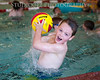 """COOLING OFF""<br /> 16x20 Boy in pool<br /> 66mm, f/2.8, ISO 5000, Nikon D700, 24-70.mm Nikon<br /> Date: July 18, 2013 Event: Dave Masur Soccer Camp 2013"