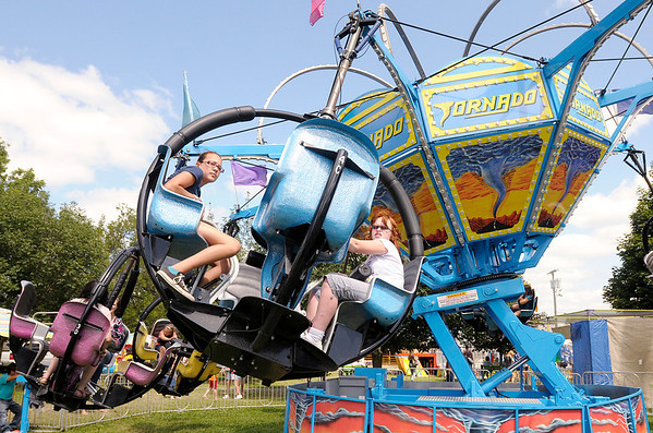 Don Knight/The Herald Bulletin<br /> From left, Kassie Gonzalez and Jeannie Larkin ride the Tornado at the 4-H Fair in Alexandria on Wednesday.