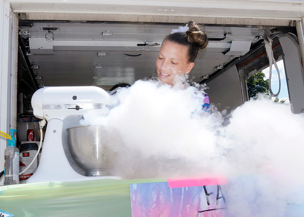 Don Knight/The Herald Bulletin<br /> Stacie Cowgill prepares a batch of liquid nitrogen ice cream in the F.A.B. Lab food truck on the midway at the 4-H Fair in Alexandria on Wednesday.