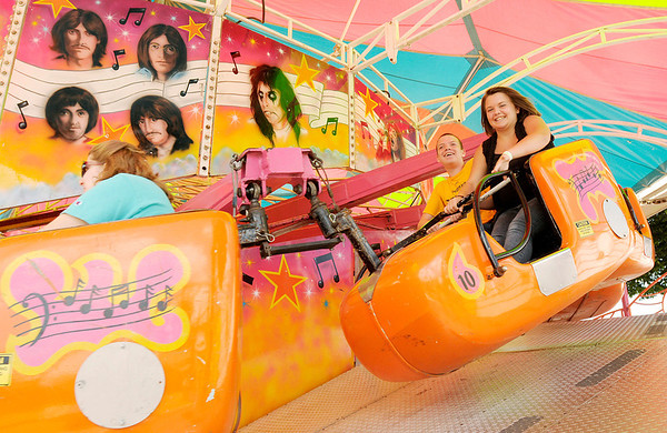 Don Knight/The Herald Bulletin<br /> Fair goers ride the Music Fest.