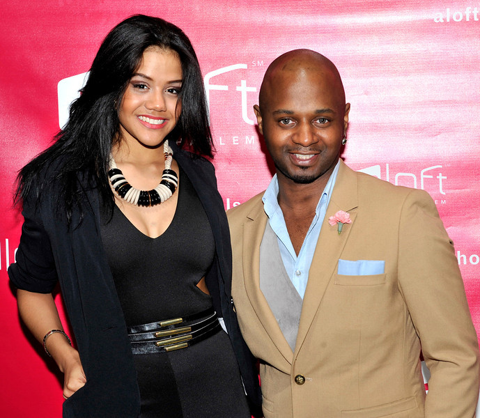 21 April 2012-New York, NY- Designer Clarence Black with actress Melanie, on red carpet, at Fashion Avenue News Magazine launch party at the Aloft Harlem Hotel. Photo Credit: Duncan Williams/Sipa USA