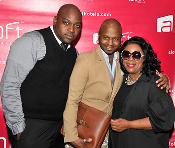 21 April 2012-New York, NY- Fashion designer Clarence Black hugs Fashion Avenue News Magazine Editor-in-Chief Sophia Davis along with PR Chris Ellis, on red carpet, at the Fashion Avenue News Magazine launch party at the Aloft Harlem Hotel. Photo Credit: Duncan Williams/Sipa USA