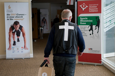 Punter with white cross on his back, Christian Resources Exibition