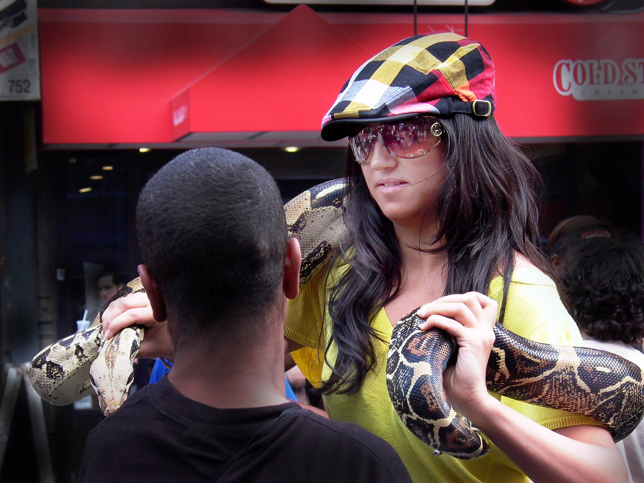 Girl with snake- trying to entice the young man? Ninth Avenue Street Fair, New York City- Leica Digilux 1