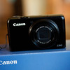 Canon Power Shot S90 <br /> Comes with original box, batter, charger, manuals, as well as extras of Camera strap, camera pouch, and 2 GB memory card,<br /> <br /> This camera is great!  Shoots in raw format, and also takes video.  I just find myself forgetting it all the time, and just using the camera on my phone.  <br /> <br /> $190 shipped and insured