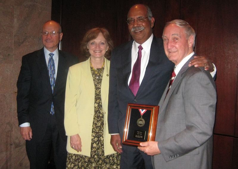 Brookdale Assistant Professor of History and WWII Center Director Paul Zigo (right) was recently recognized by the American Conference on Diversity for his commitment to diversity and the community. At the awards dinner on Thursday night, April 29, Prof. Zigo received a Humanitarian Award for the WWII Center's commitment to education and conflict resolution. Paying tribute to Prof Zigo at the event are Executive VP Jim Sulton, Dean Patricia Sensi, and Vice President Webster Trammell.