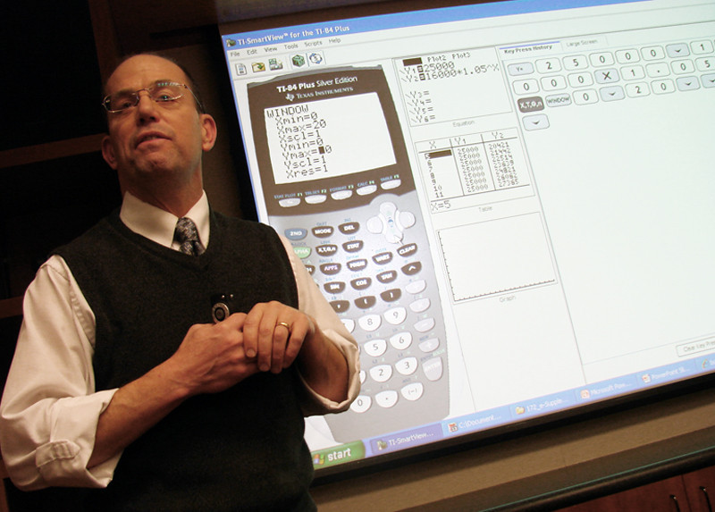 Associate Math Professor Greg Liano is demonstrating the use of graphing calculators through MAPLE, at the Feb. 18 Board of Trustees meeting.