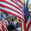 John Cross<br /> John Cross<br /> Flags carried by the Patriot Guard Riders and a miliary color guard flutter in the breeze outside of the Grace Lutheran Church in Waseca on Monday during a funeral for fallen Marine Caleb Erickson.